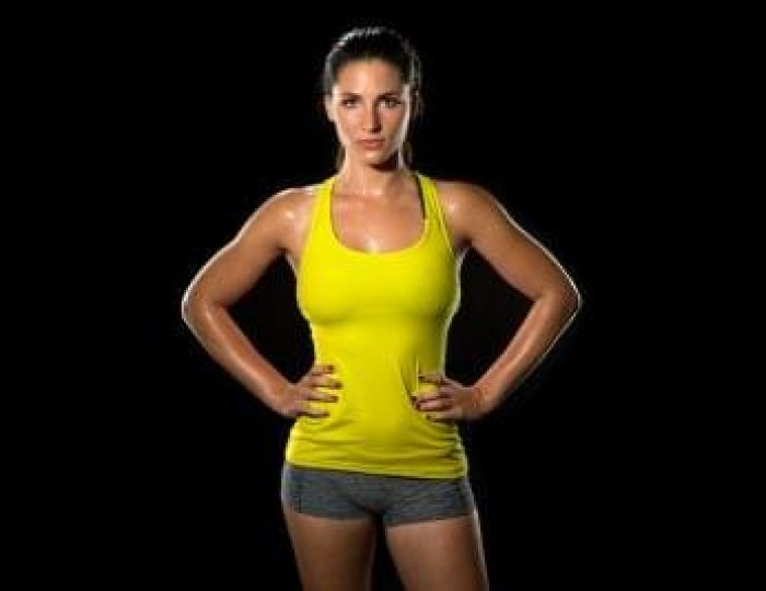 Keto-Diet-Exercise-Attractive-fit-thin-slim-toned-female-body-athlete-isolated-on-black-standing-confidently-pose-powerful-woman